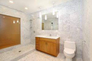 Wainscot Tiling Contractor with Carrara Stone